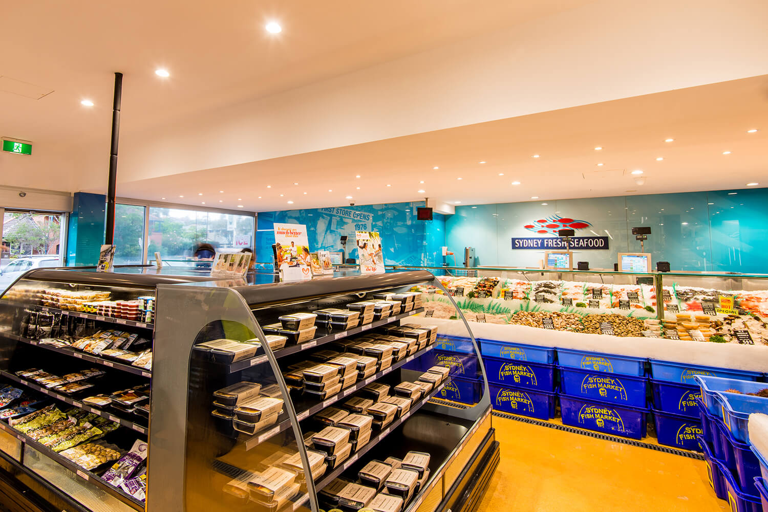 Commercial lighting design by Afterglow showing Harris Farms store seafood display