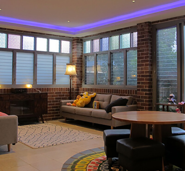 Lounge room interior with coloured lighting in ceiling
